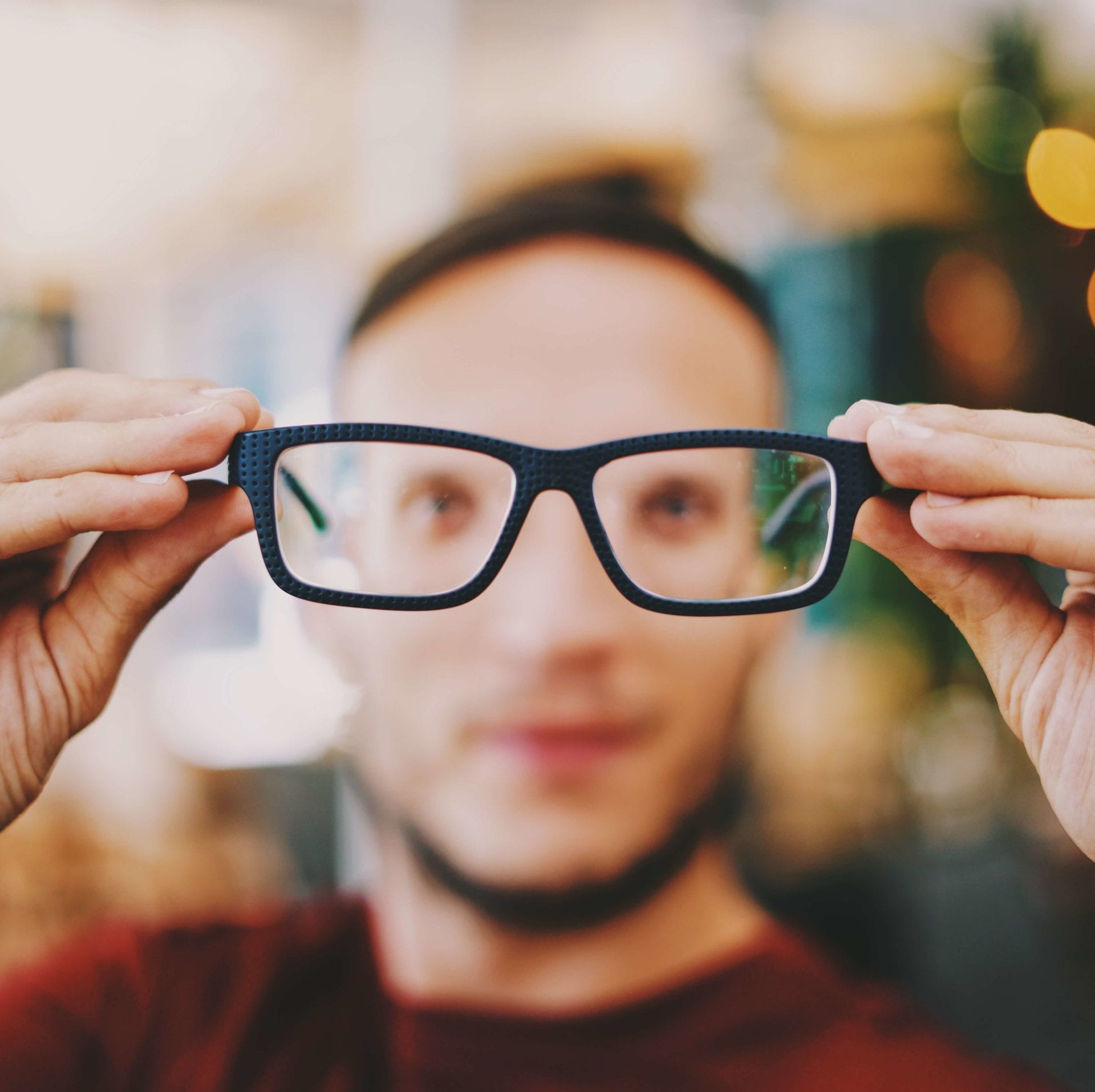 man looking through glasses