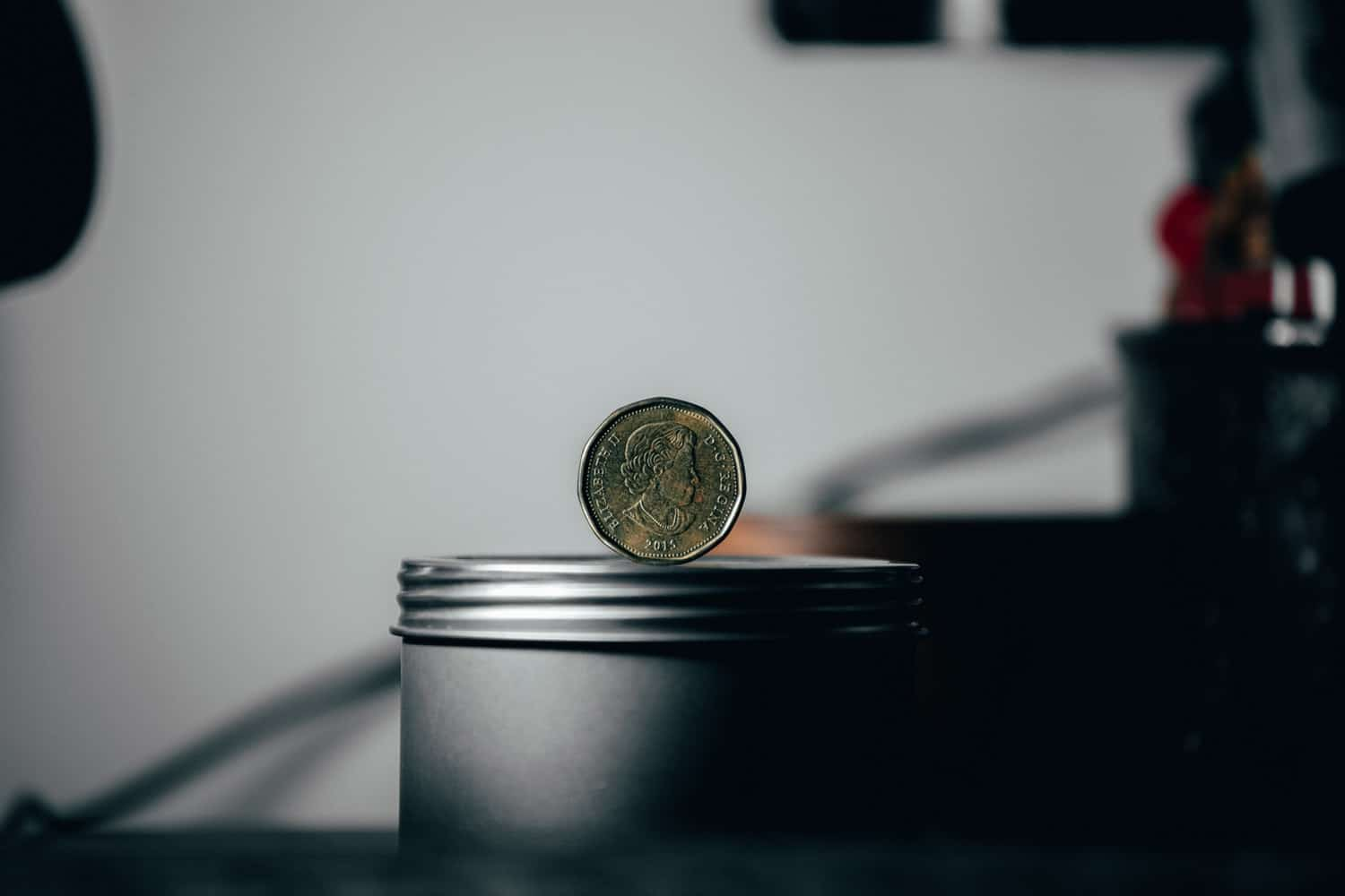 coin on top of can
